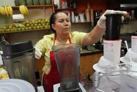Celina Alvarez, 51, works at Jugueria de regreso al Eden, her shop in the Queens borough of New York, Monday. (AP Photo/Tina Fineberg)