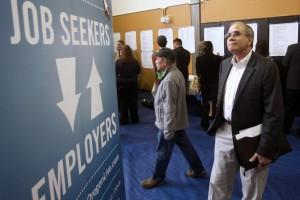 Job seekers attend a jobs fair in Portland, Oregon.  (AP Photo/Rick Bowmer, File)