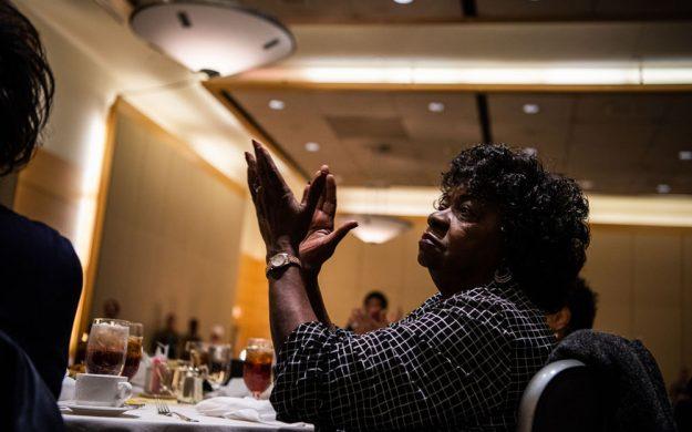 A senior citizen clapping.
