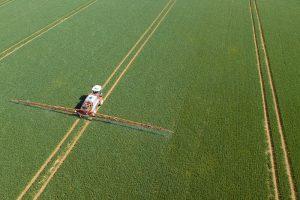 A crop sprayer applying pesticides.