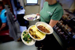waitress balancing plates