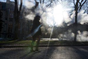 Student walking on Philadelphia college campus